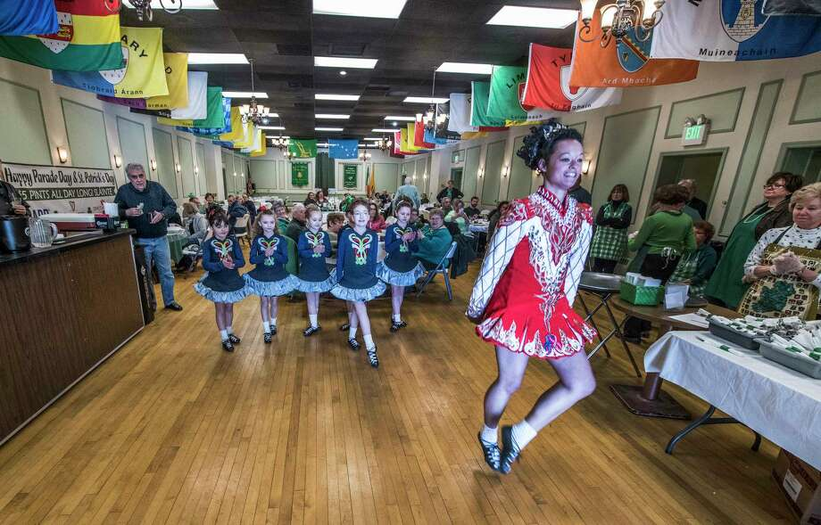 Kaitlin Culpepper, right, leads Farrell School of Irish Dance members in a performance of Irish step dancing at the Ancient Order of Hibernians Hall during a corned beef and cabbage dinner on Friday, March 16, 2018, Albany, N.Y. (Skip Dickstein/Times Union) Photo: SKIP DICKSTEIN / 20043159A
