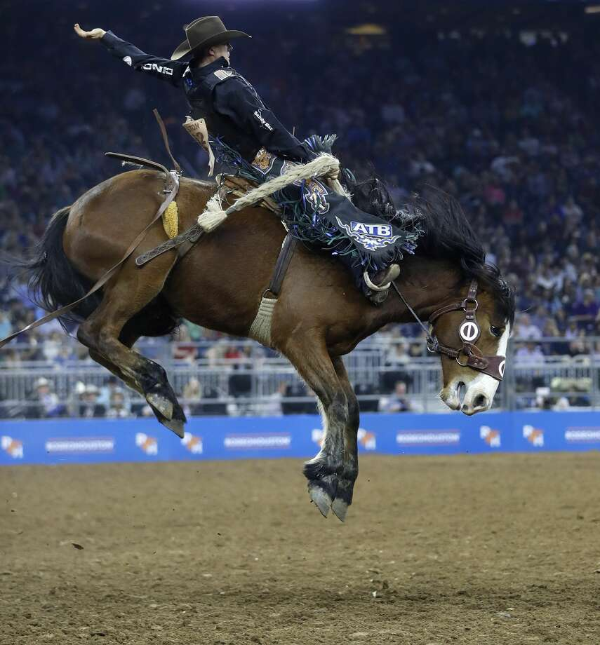 Zeke Thurston rides Banger Main in the Saddle Brionc Riding during the Wild Card competition at the Houston Livestock Show and Rodeo at NRG Stadium, Friday, March 16, 2018, in Houston.  ( Karen Warren / Houston Chronicle ) Photo: Karen Warren/Houston Chronicle