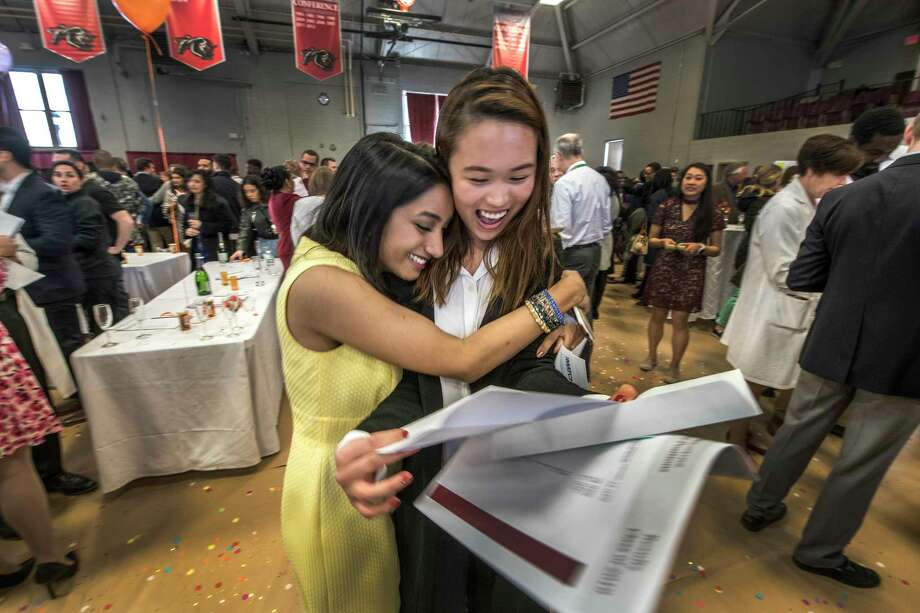 Supraja Swamy, left Emily Tou embrace and share the moment they found out they had gotten their favored location for their continued medical education during Match Day for Albany Medical College held at the Albany College of Pharmacy gym Friday March 16, 2018 Albany, N.Y.  Swamy will go to Case Western/Univ Hospital Cleveland, OH Medical Center  and Tou will head to Cedars-Sinai Medical Center in Los Angles, CA.  (Skip Dickstein/Times Union) Photo: SKIP DICKSTEIN / 20043241A