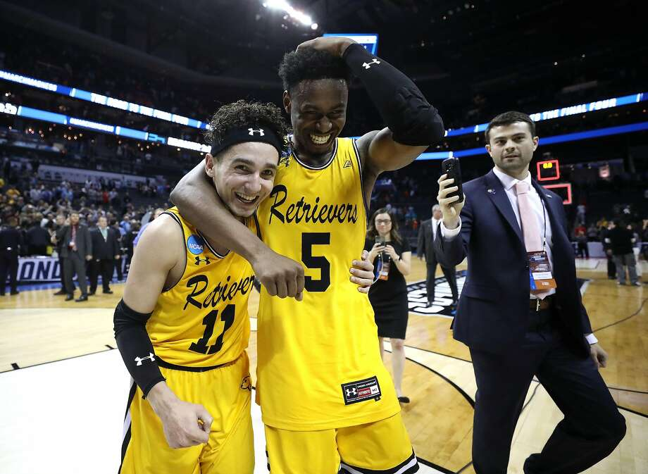 CHARLOTTE, NC - MARCH 16:  K.J. Maura #11 and teammate Jourdan Grant #5 of the UMBC Retrievers celebrate their 74-54 victory over the Virginia Cavaliers during the first round of the 2018 NCAA Men's Basketball Tournament at Spectrum Center on March 16, 2018 in Charlotte, North Carolina.  (Photo by Streeter Lecka/Getty Images) Photo: Streeter Lecka, Getty Images