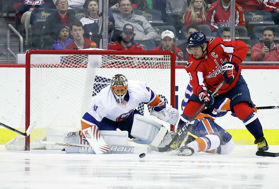 Washington Capitals left wing Alex Ovechkin (8), from Russia, works the puck in front of New York Islanders goaltender Jaroslav Halak (41), from Slovakia, in the first period of an NHL hockey game, Friday, March 16, 2018, in Washington. (AP Photo/Alex Brandon) Photo: Alex Brandon / Copyright 2018 The Associated Press. All rights reserved.