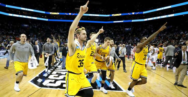 CHARLOTTE, NC - MARCH 16:  The UMBC Retrievers celebrate their 74-54 victory over the Virginia Cavaliers during the first round of the 2018 NCAA Men's Basketball Tournament at Spectrum Center on March 16, 2018 in Charlotte, North Carolina.  (Photo by Streeter Lecka/Getty Images)