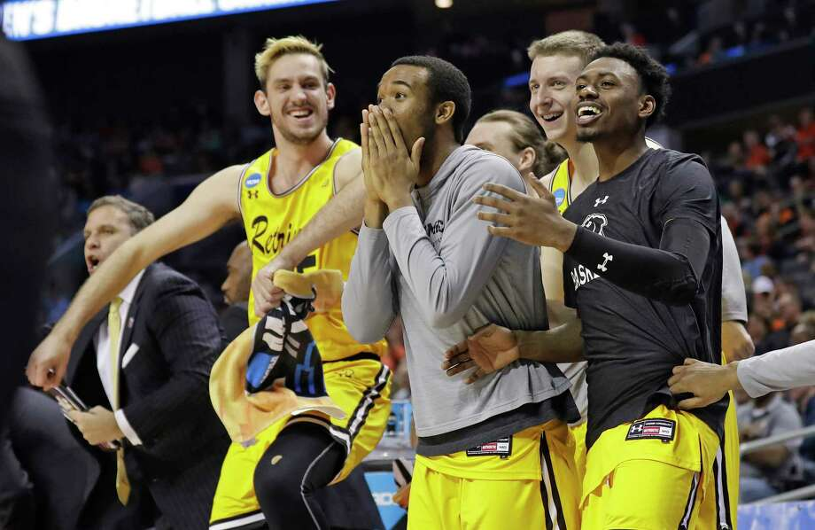 UMBC players celebrate a teammate's basket against Virginia during the second half of a first-round game in the NCAA men's college basketball tournament in Charlotte, N.C., Friday, March 16, 2018. (AP Photo/Gerry Broome) Photo: Gerry Broome / Copyright 2018 The Associated Press. All rights reserved.
