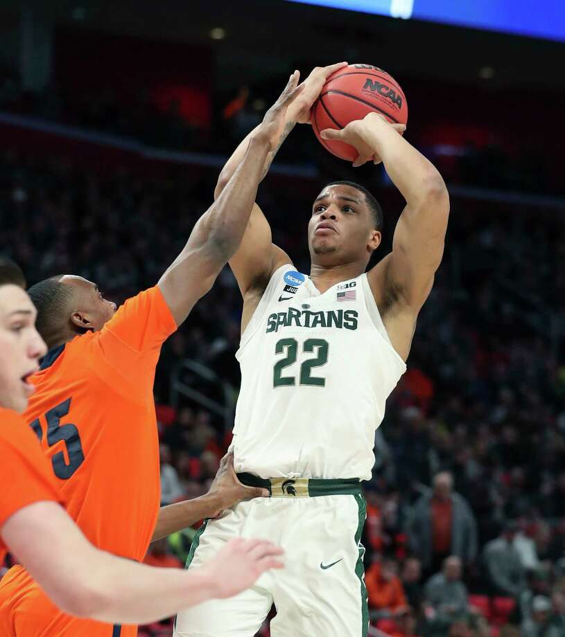 Michigan State guard Miles Bridges (22) shoots over Bucknell guard Nate Jones (15) during the first half of a first round game in the NCAA college basketball tournament, Friday, March 16, 2018, in Detroit. (AP Photo/Carlos Osorio) Photo: Carlos Osorio / Copyright 2018 The Associated Press. All rights reserved.
