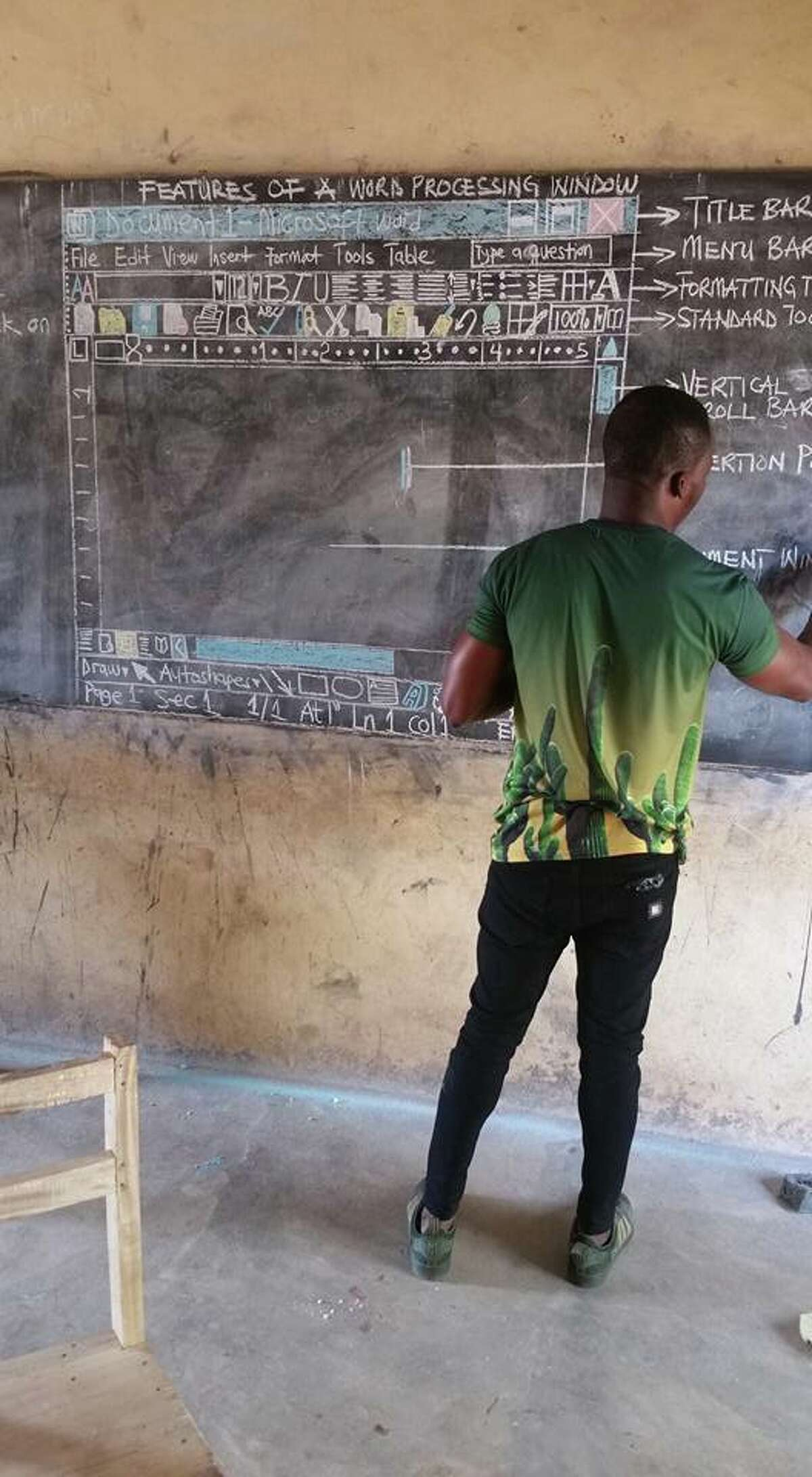 Richard Appiah Akoto sketches the layout of Microsoft Word on the blackboard atBetenase M/A Junior High School in Sekyedomase, Ghana, which until recently had no computers on which students could learn.