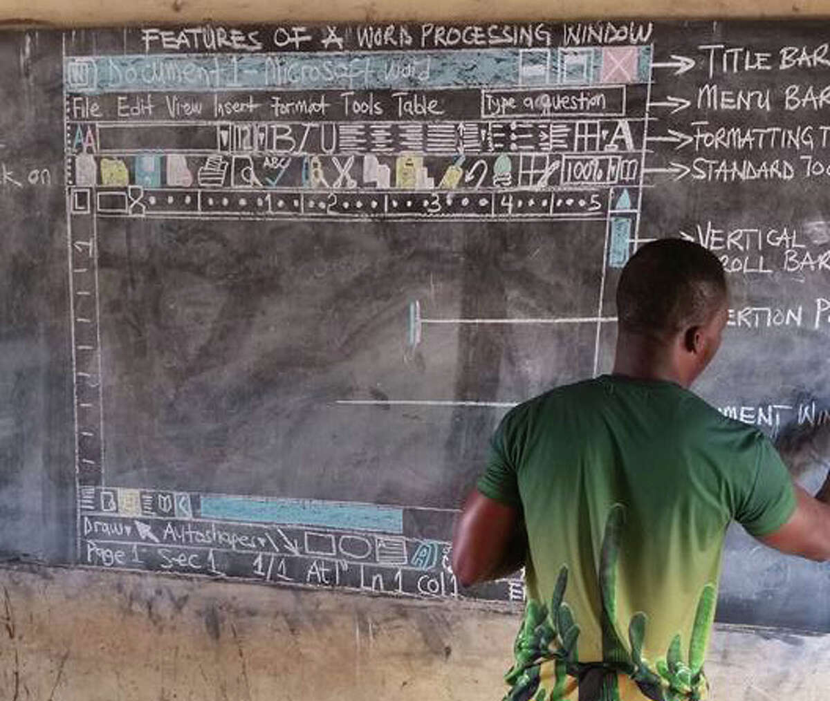 Richard Appiah Akoto sketches the layout of Microsoft Word on the blackboard at Betenase M/A Junior High School in Sekyedomase, Ghana, which until recently had no computers on which students could learn.