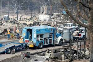 PG&E crews work on Vintage Circle in the heart of in the Fountaingrove neighborhood, destroyed by the Tubbs Fire, in Santa Rosa, Calif. on Tuesday Oct. 17, 2017.
