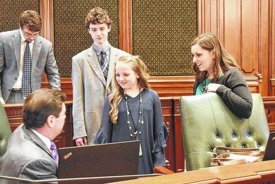 Camden Kessler (center, left) from Pana and Alyssa Carriker (center) from Carlinville were pages in the Illinois House for state Rep. Avery Bourne, R-Raymond. Bourne introduced them to her colleagues before the start of session.