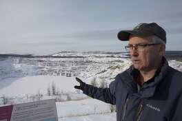 Asbestos City Councilman Alain Roy near the open pit mine in Asbestos, Quebec, Canada, on Feb. 9, 2018.