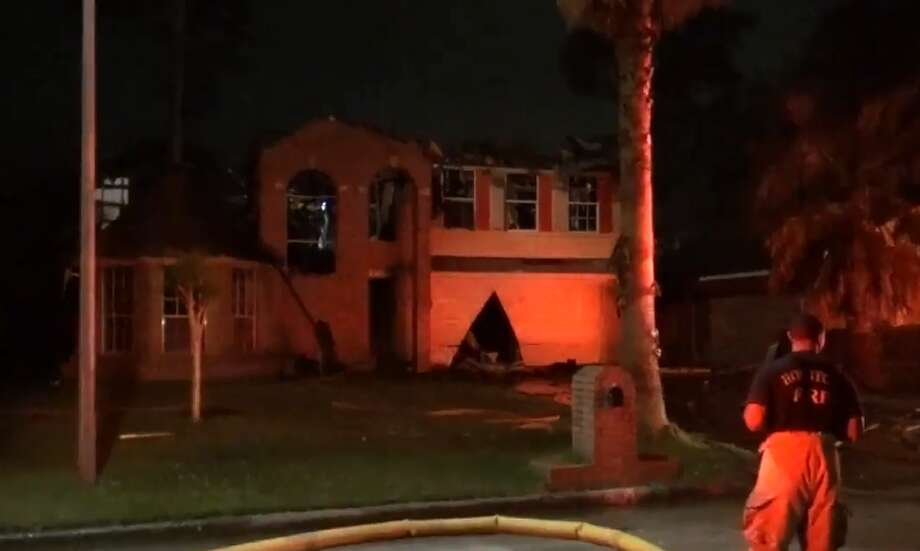 Firefighters were dispatched to Pine Cone Drive near Old Oak Lane around 4 a.m., where they found a two-story brick house engulfed in flames, officials said. Photo: Metro Video LLC / For The Houston Chronicle