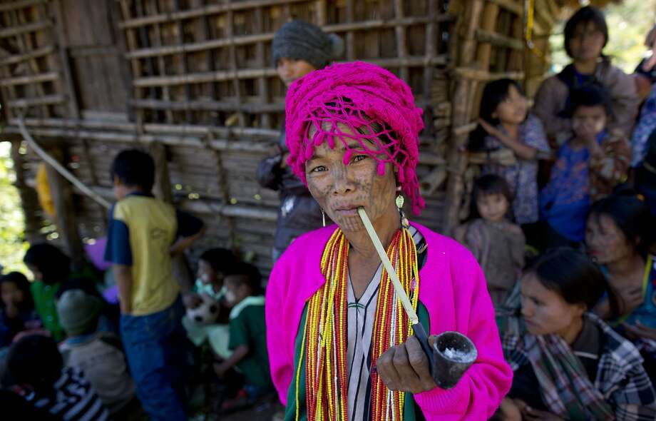 An ethnic Chin woman with a traditional tattooed face smokes a pipe in Kyar Do village in Chin State in 2013. The Chin are among many minorities who face discrimination in Myanmar. Photo: Gemunu Amarasinghe, Associated Press