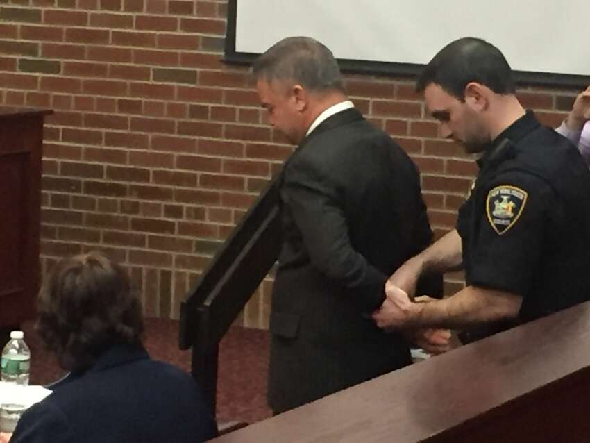 John W. Cole is handcuffed after being convicted of felony assault and alcohol-impaired driving in Saratoga County Court in Ballston Spa on March 16, 2018.