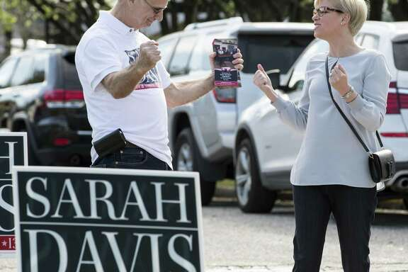 State Rep. Sarah Davis, R-Houston, celebrates with campaign volunteer Michael Sternesky at West University Elementary School. Davis won despite support for her opponent from Gov. Greg Abbott.