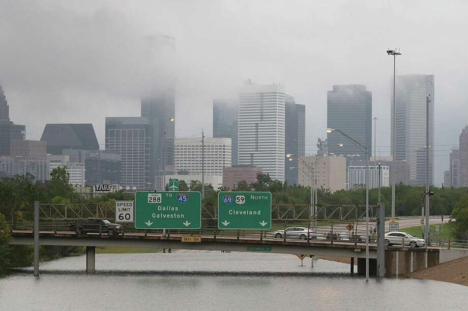 Downtown Houston and submerged highways are seen August 27, 2017 as the city battles with tropical storm Harvey and resulting floods. / AFP PHOTO / Thomas B. SheaTHOMAS B. SHEA/AFP/Getty Images Photo: THOMAS B. SHEA, Contributor / AFP/Getty Images / Internal