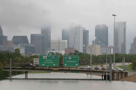 Downtown Houston and submerged highways are seen August 27, 2017 as the city battles with tropical storm Harvey and resulting floods. / AFP PHOTO / Thomas B. SheaTHOMAS B. SHEA/AFP/Getty Images