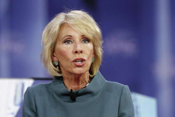 Education Secretary Betsy DeVos speaks last month during the Conservative Political Action Conference (CPAC), at National Harbor, Md. DeVos is getting less than a ringing endorsement from the White House after uncomfortable television interviews raised questions about her commitment to help underperforming schools and support for President Donald Trumps school safety proposal.