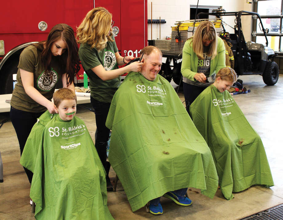 "The Edwardsville Fire Department hosted a St. Baldrick's fundraising event Saturday, March 17. Local citizens gathered to ""Brave the Shave"" and shave their heads to support childhood cancer research. Photo: Cody King • Cking@edwpub.net"