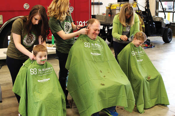 "The Edwardsville Fire Department hosted a St. Baldrick's fundraising event Saturday, March 17. Local citizens gathered to ""Brave the Shave"" and shave their heads to support childhood cancer research."