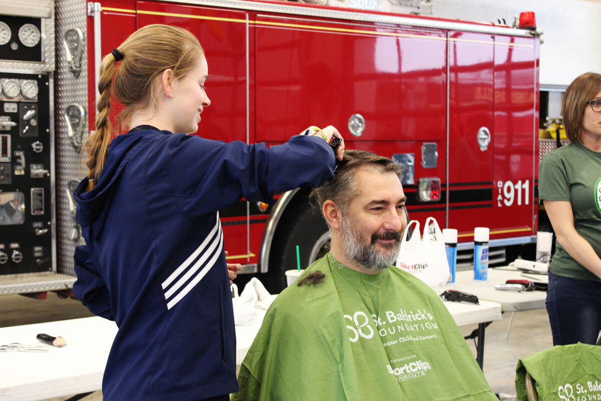 John Roberts, of Glen Carbon, was one of the volunteers to shave his head for the St. Baldrick's fundraiser on Saturday, hosted by the Edwardsville Fire Department.