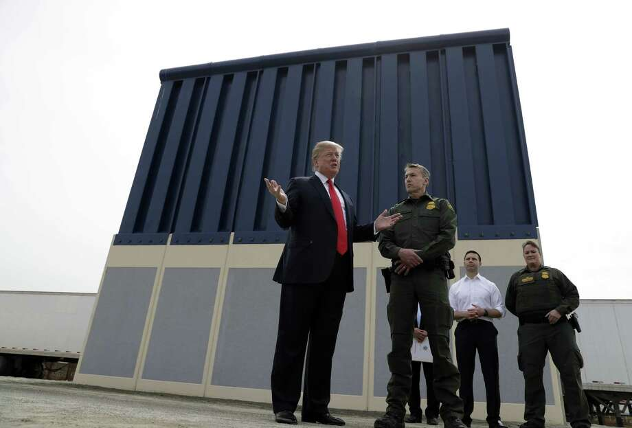 "President Donald Trump reviews border wall prototypes on March 13 in San Diego. During the visit Trump said, ""It will save thousands and thousands of lives, save taxpayers hundreds of billions of dollars by reducing crime, drug flow, welfare fraud and burdens on schools and hospitals. The wall will save hundreds of billions of dollars many, many times what it is going to cost. ... We have a lousy wall over here now but at least it stops 90, 95 percent. When we put up the real wall, we're going to stop 99 percent, maybe more than that."" However, Congress' main watchdog found that the government does not have a way to show how barriers prevent illegal crossings from Mexico. A Government Accountability Office report last year said U.S. Customs and Border Protection ""cannot measure the contribution of fencing to border security operations along the southwest border because it has not developed metrics for this assessment."" Photo: Evan Vucci, STF / Associated Press / Copyright 2018 The Associated Press. All rights reserved."