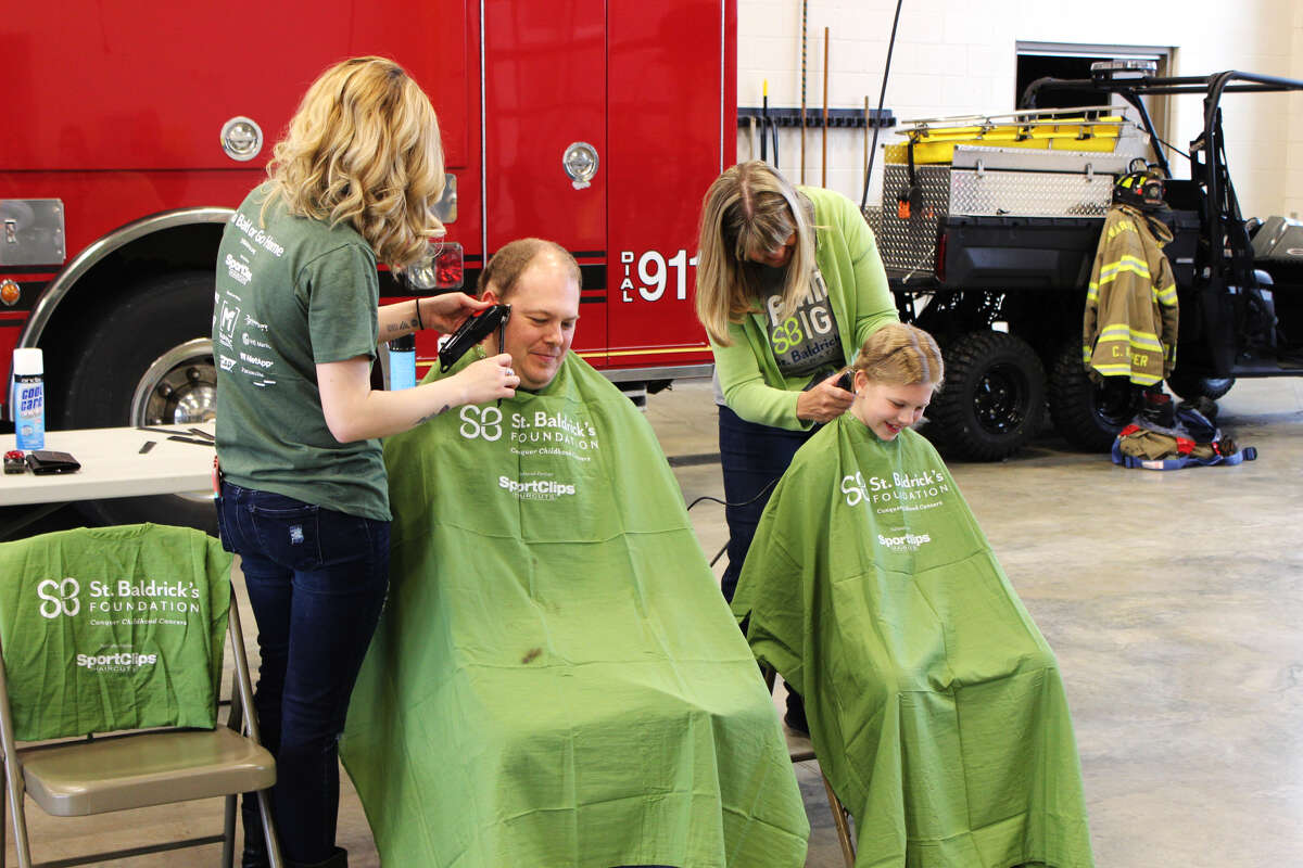 From left to right: Sean Douglas, of the Edwardsville Fire Department, and his daughter Rozalyn Douglas, took part in the St. Baldrick's fundraiser held at the EFD Saturday morning.