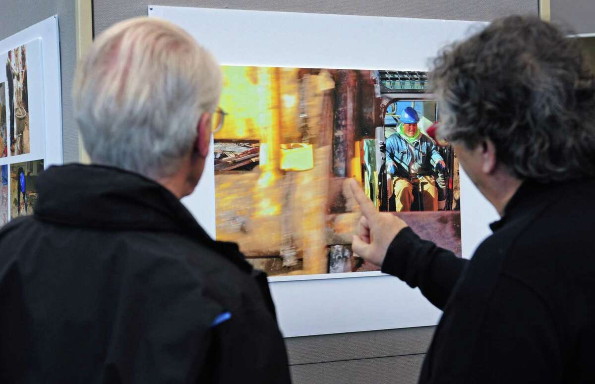 Photographer Richard Frank, right, discusses his work with Elton Robinson during a reception for the newly installed exhibit in the Library's Great Hall, Transforming The Westport Library, Friday, March 16, 2018, which showcases renderings of the planned renovation by architect Henry Myerberg's New York-based design firm, HMA2, paired with photographs of current construction on the Library's first floor by Frank at the library in Westport, Conn.