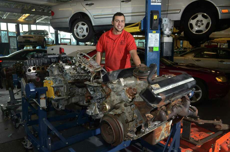 Norwalk resident Christopher Marrero, a student at J.M. Wright Technical High School, is studying automotive technology at the school in Stamford. Photo: Erik Trautmann / Hearst Connecticut Media / Norwalk Hour