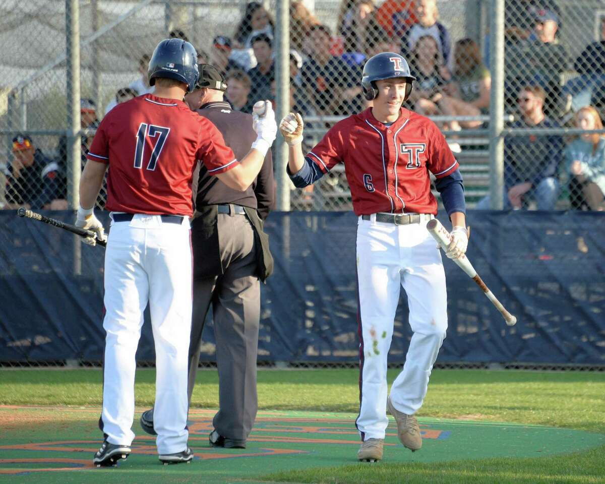 Weston Valasek (6) celebrates scoring Tompkins' first run during the first inning of a varsity baseball game between the Seven Lakes Spartans and the Tompkins Falcons on Tuesday March 14, 2018 at Seven Lakes HS, Katy, TX.