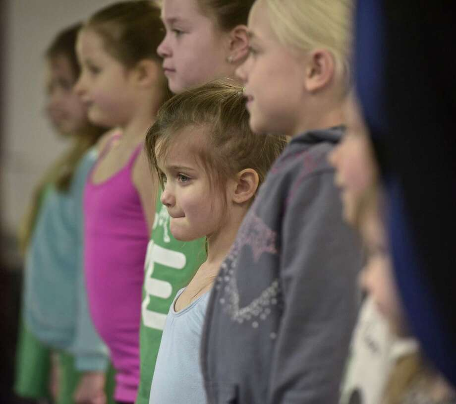 Cate Buckley, 5, of Sandy Hook, listens to instructions during a free Irish dance lesson hosted by Ashurst Academy of Irish Dance hosted on Saturday morning, March 17, 2018, in Newtown, Conn. Photo: H John Voorhees III / Hearst Connecticut Media / The News-Times