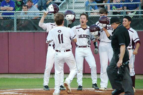 Teammates congratulate Clear Creek's Alec Lamar (11) after his home run Friday night against Clear Springs.
