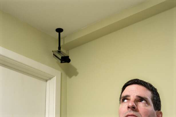 A man uses surveillance cameras to spy on his wife.