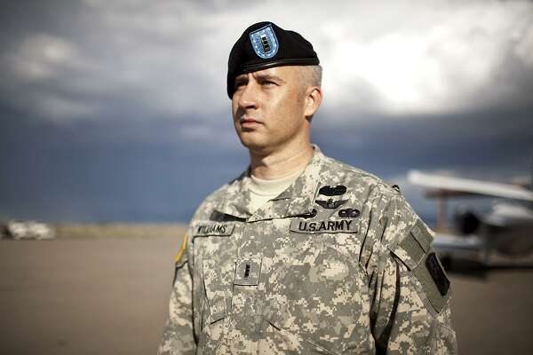METRO - Chief Warrant Officer 4 and U.S. Army pilot Dave Williams stands for a portrait on Thursday, September 16, 2010 at Dona Ana County at Santa Teresa Airport in Santa Teresa, New Mexico. Williams and his co-pilot were shot down in their Apache helicopter near Karbala, Iraq on March 24, 2003. Williams who lives in El Paso, Texas with his wife and two kids was a POW for 24 days before being rescued by Marines. Williams is now stationed in Ft. Bliss, Texas where he is in an aviation unit. PHOTO BY IVAN PIERRE AGUIRRE/ SPECIAL TO THE SAN ANTONIO EXPRESS-NEWS