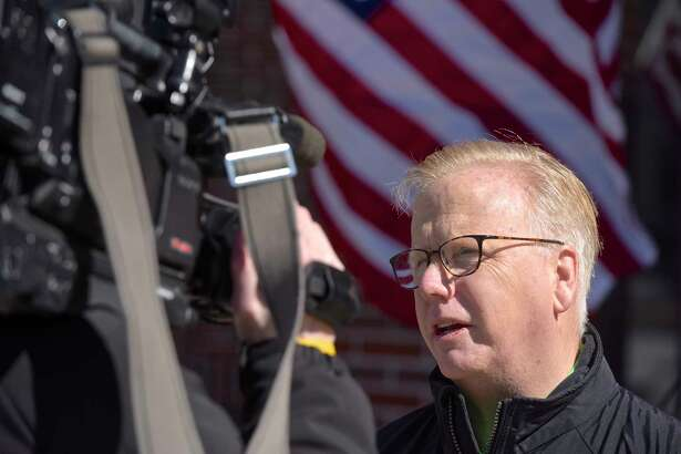 Mayor Mark Boughton gives a media interview where he addressed his collapsing from dehydration during an event for Republican gubernatorial candidates before a the raising of the Irish flag at Danbury City Hall on Saturday afternoon, March 17, 2018, in Danbury, Conn.