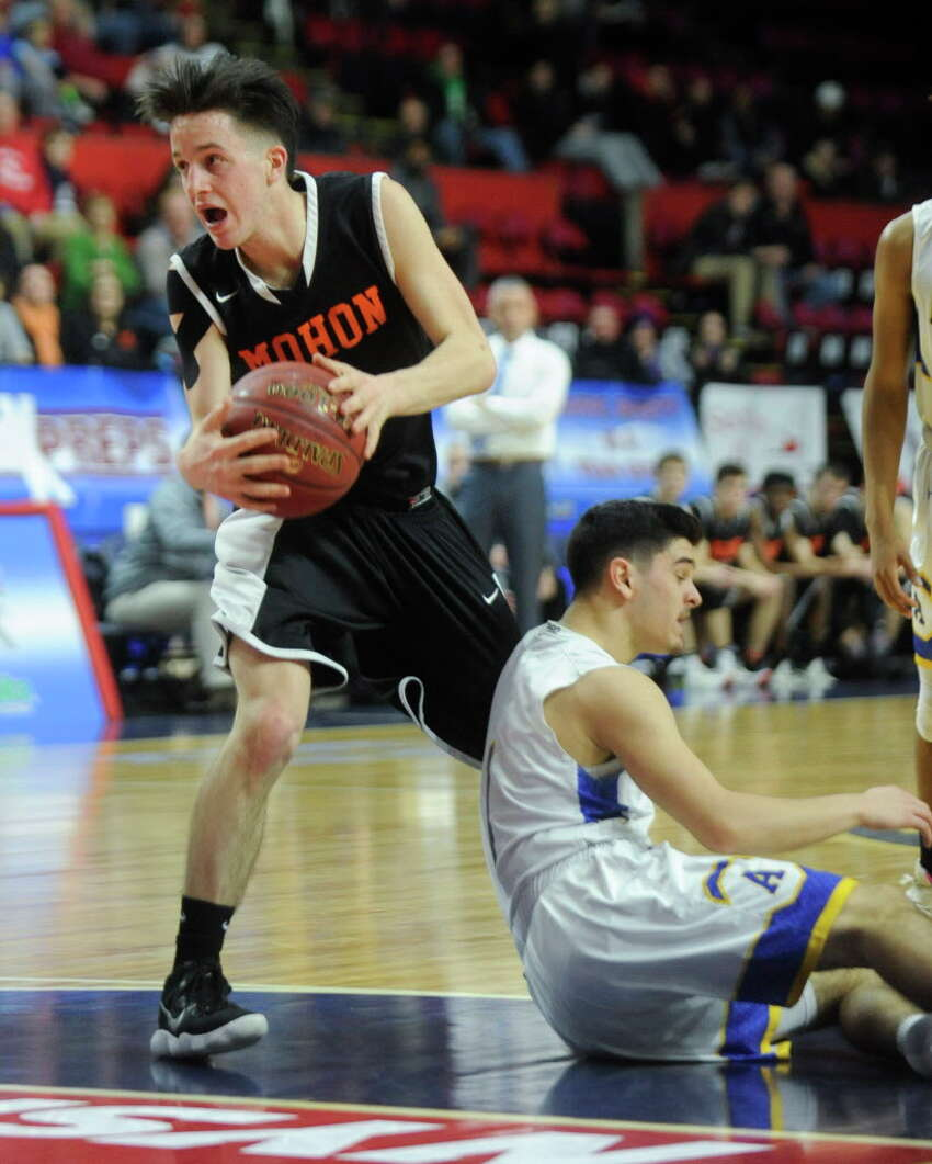 Mohonasen's Duncan Tallman, left, gets the ball away from Ardsley's Frank Belarge, right, in a NYSPHSAA Class A Boys Basketball semifinal on Saturday, March 17, 2018, at Floyd L. Maines Arena in Binghamton, N.Y. (Tim Roske/Special to the Times Union)