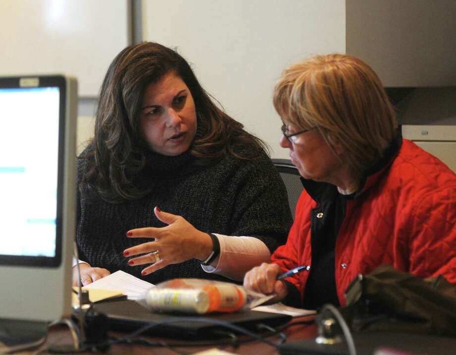Greenwich Commission on Aging Director Lori Contadino, left, assists Greenwich resident Margarete Catalano at the Medicare Part D counseling session at the Senior Center in Greenwich, Conn. Monday, Nov. 27, 2017. Presented by the Greenwich Commission on Aging, counselors helped local seniors get signed up for Medicare and find the best possible deal considering what prescriptions they are on. Photo: Tyler Sizemore / Hearst Connecticut Media / Greenwich Time