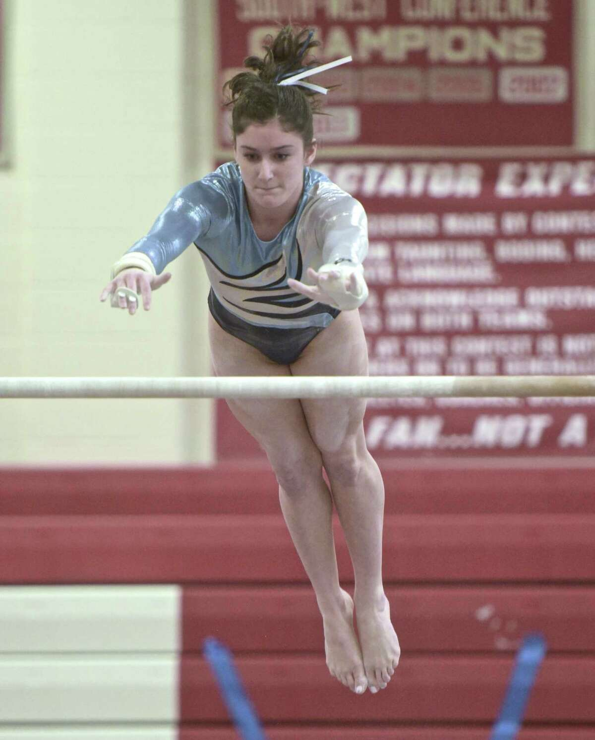 Jessica Olin, Wilton High School, competes in the uneven bars at the Connecticut State Open gymnastics meet, Saturday, March 3, 2018, at Pomperaug High School, in Southbury, Conn.