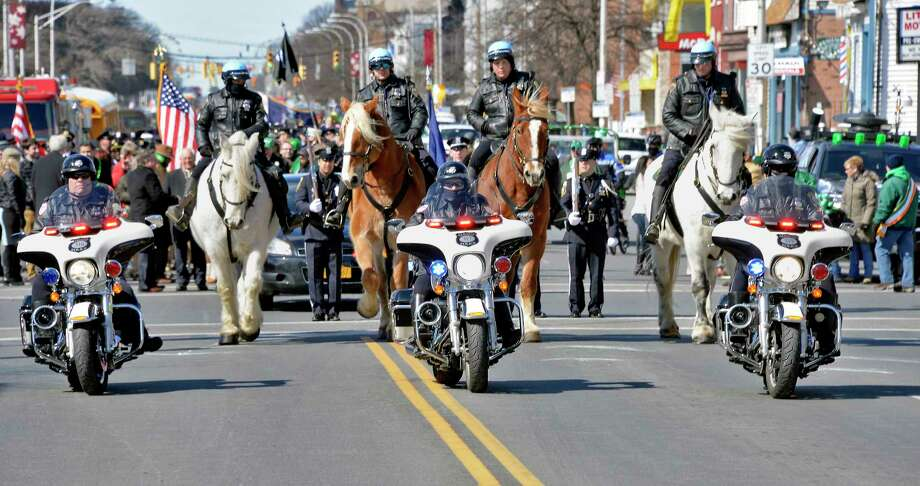 Albany Police motorcycle and mounted units lead the 68th Annual Albany St. Patrick's Day Parade down Central Avenue Saturday March 17, 2018 in Albany, NY.  (John Carl D'Annibale/Times Union) Photo: John Carl D'Annibale, Albany Times Union / 20043028A