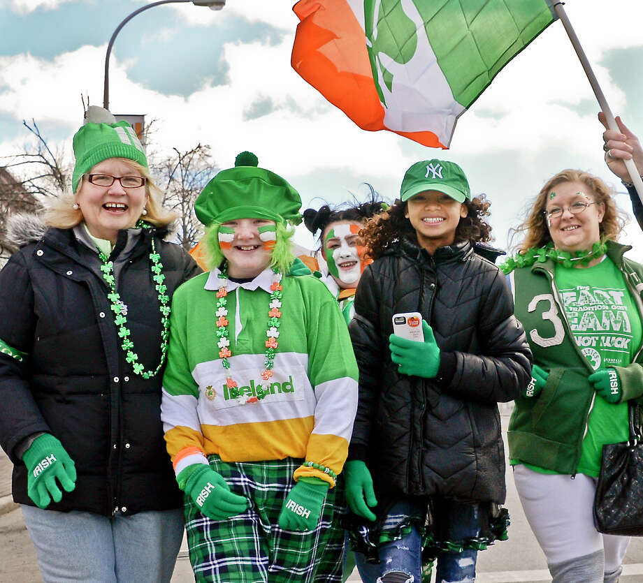 Dressed for the occasion, from left, Joellen Reynolds, Jersey Reynolds, 11, Destiny Reynolds, 18, Shellie Bryant, 11, and Christine Hart, all of Clifton Park, arrive for the 68th Annual Albany St. Patrick's Day Parade Saturday March 17, 2018 in Albany, NY.  (John Carl D'Annibale/Times Union) Photo: John Carl D'Annibale, Albany Times Union / 20043028A