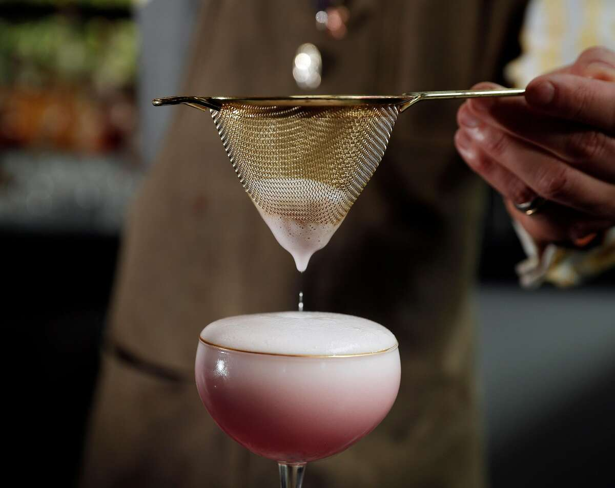The Sakura cocktail served by bartender Ari Terrell at the Kabuki Hotel bar in San Francisco, Calif., on Thursday, March 15, 2018. The hotel lobby and bar were recently renovated with more seating areas added.
