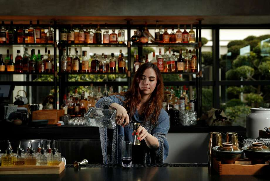 Beverage Director Stephanie Wheeler behind the bar at the Kabuki Hotel bar in San Francisco. Photo: Carlos Avila Gonzalez, The Chronicle