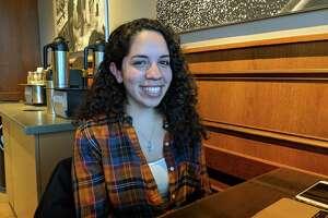 Andrea Servan, 27, is doing homework at Starbucks in Riverside.