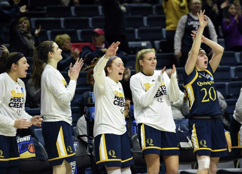 Quinnipiac players celebrate from the bench at the end of Saturday's win over Miami in Storrs. Photo: Stephen Dunn / Associated Press / FR171426 AP