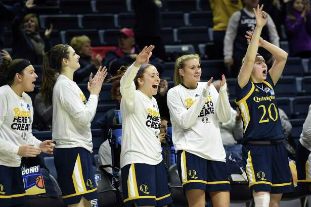 Quinnipiac players celebrate from the bench at the end of Saturday's win over Miami in Storrs.