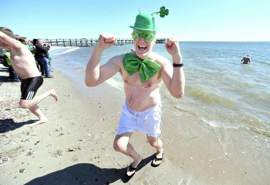 Eric Twombly of Milford emerges from the Long Island Sound during the Leprechaun Leap at Walnut Beach in Milford on March 17, 2018.  The event raised money for the Literacy Volunteers of Southern Connecticut. Photo: Arnold Gold / Hearst Connecticut Media / New Haven Register