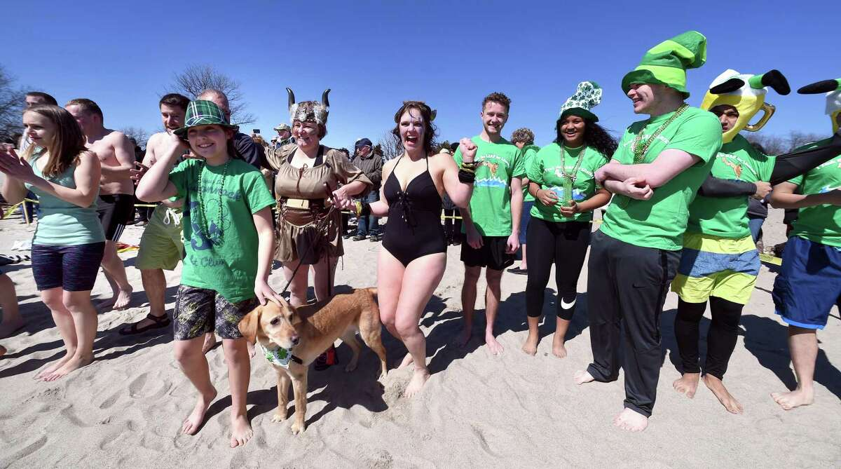 Leapers prepare to enter the Long Island Sound for the Leprechaun Leap at Walnut Beach in Milford on March 17, 2018. The event raised money for the Literacy Volunteers of Southern Connecticut.