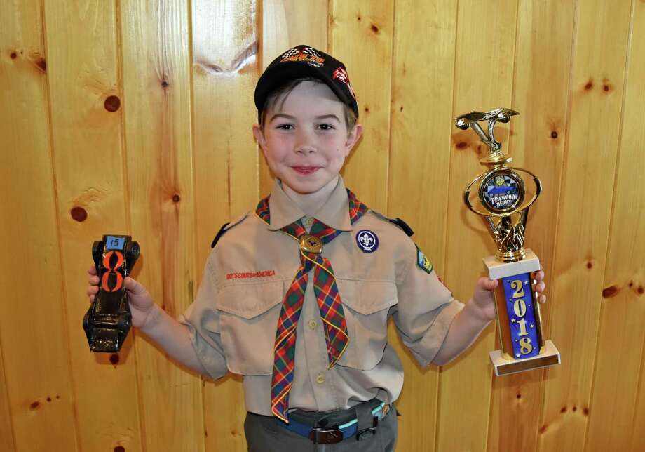 First place winner Austin Sciulla with his winning car and trophy at the Pinewood Derby Championship at Seton Scout Reservation in Greenwich. Photo: Ray Garrison