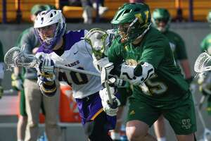 UAlbany's Kyle McClancy pursues Vermont's Ian Mackay drives with the ball during a game at Casey Stadium on Saturday, Mar. 17, 2018, in Albany, N.Y.