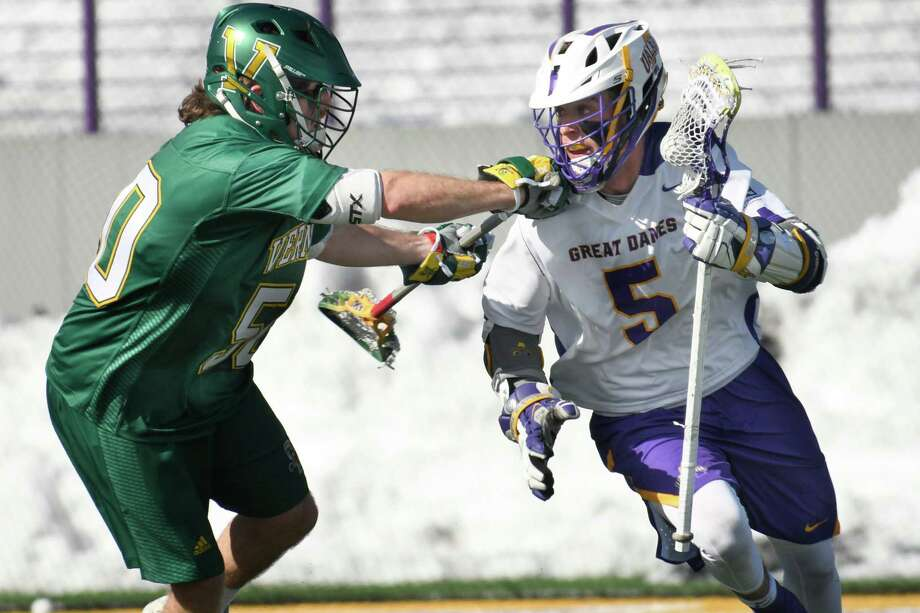 Vermont's James Leary pushes UAlbany's Connor Fields during a game at Casey Stadium on Saturday, Mar. 17, 2018, in Albany, N.Y. Photo: Jenn March, Times Union / © Jenn March 2018 © Albany Times Union 2018
