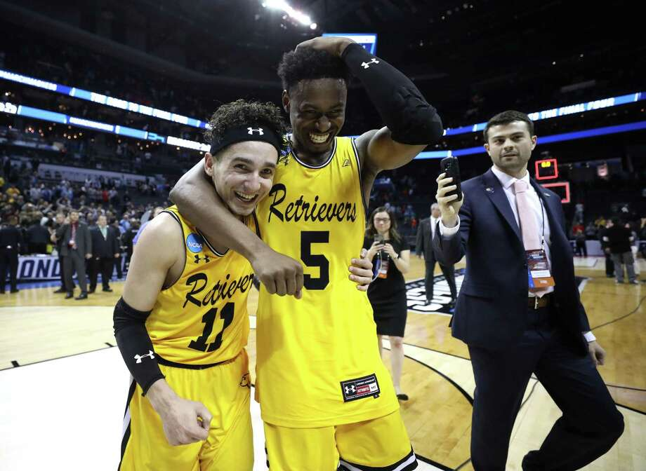 K.J. Maura, left, and teammate Jourdan Grant of UMBC celebrate their 74-54 victory over top-seeded Virginia on Friday night. Photo: Streeter Lecka / Getty Images / 2018 Getty Images
