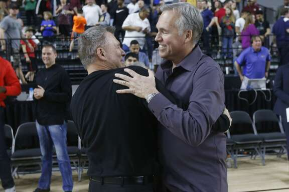 Marshall head coach Dan D'Antoni greet his brother, Houston Rockets head coach Mike D'Antoni after Marshall won the NCAA Conference USA Men's Basketball Championship in Frisco, Texas, Saturday, March 10, 2018. Marshall defeated Western Kentucky 67-66. (AP Photo/Michael Ainsworth)